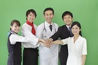 手を重ね合う様々な職業の日本人男女の合成用素材