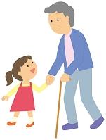 孫と散歩をする老人女性