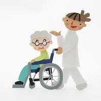 車椅子を押す介護士のクラフト