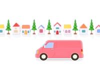 ピンクのバンと家並み