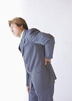腰が痛いビジネスマン