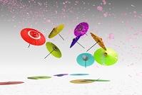 乱舞する和傘と桜の花びら