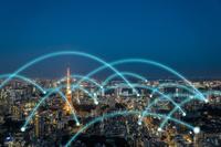 東京タワーとビル群と光のネットワーク 合成