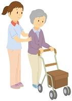 シルバーカーを押して歩く老人女性と介護士
