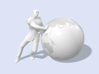 地球儀を押すビジネスマン