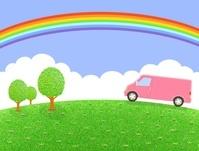 丘を走るピンクのバンと虹