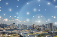 東京スカイツリーとビル群と光のネットワーク 合成