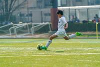 神奈川県 サッカーの試合をする男の子