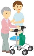 歩行器を押して歩く老人女性と介護士