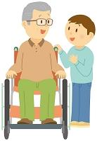 車椅子に乗る祖父に話しかける孫