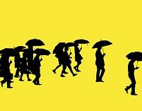 傘をさす人々のシルエット