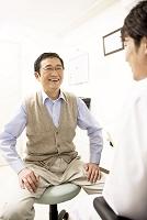 中高年男性患者・青年医師7