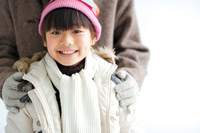 コートを着た日本人の女の子