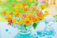 キャンディリリーとヒマワリの花