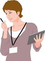 タブレットを操作する若いビジネス女性