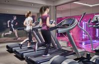 ランニングマシンでトレーニングする女性