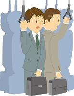 満員の電車で通勤する中年男性