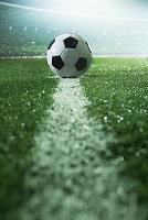 ラインに置かれたサッカーボール