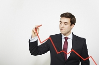グラフを描くビジネスマン