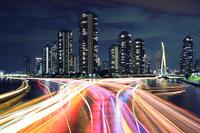 東京都 隅田川の屋形船の光跡の夜景 永代橋より撮影