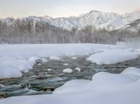 長野県白馬村の五竜岳の雪是色