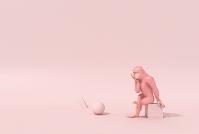 考えるピンクの猿