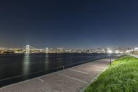 東京都 豊洲ぐるり公園とレインボーブリッジとビル群の夜景